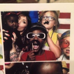 Olivia and her family in a photo booth